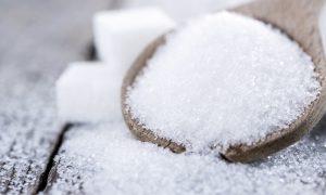 Heap of Sugar on vintage wooden background